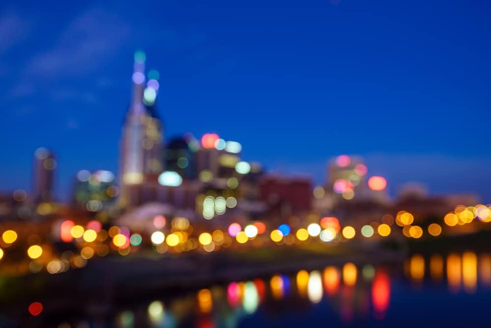 A blurred shot of the Nashville Skyline, including the famed Broadway Street